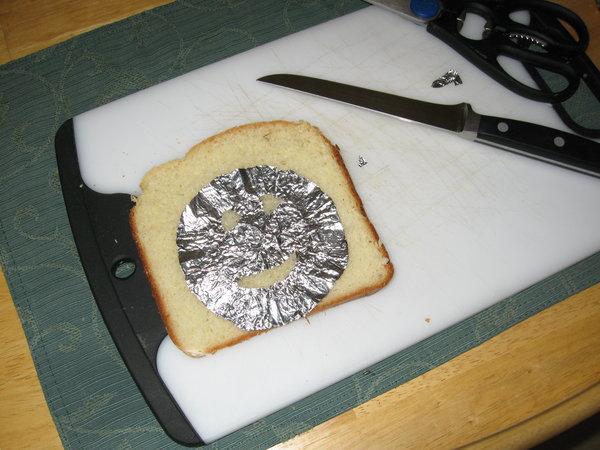 Happy toast shield