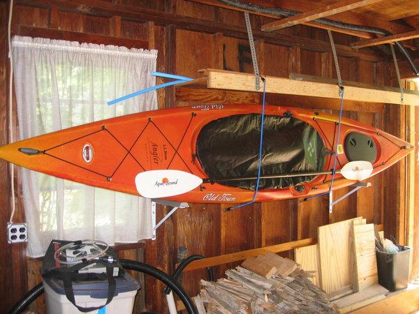 Kayak mounted to garage wall